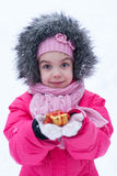 Young girl playing in the snow Stock Photos