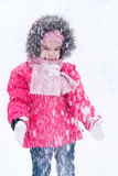 Young girl playing in the snow Stock Images