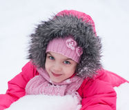 Young girl playing in the snow Royalty Free Stock Photos