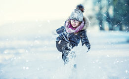 Young girl are playing with snow.Beauty Winter happy Girl Blowing Snow in frosty winter park or outdoors. Royalty Free Stock Photo