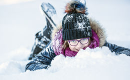 Young girl are playing with snow.Beauty Winter happy Girl Blowing Snow in frosty winter park or outdoors. Royalty Free Stock Photography