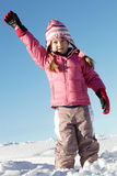 Young Girl Playing In Snow On Holiday In Mountains Royalty Free Stock Photography