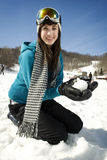 Young girl playing in snow at ski resort Stock Photos