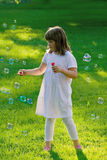 Young girl playing with soap bubbles Royalty Free Stock Photo