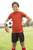 Young Girl Playing Soccer Stock Image