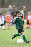 Young Girl Playing Soccer. A young girl playing in a soccer league Royalty Free Stock Photography