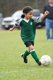 Young Girl Playing Soccer. A young girl playing in a soccer league Royalty Free Stock Images