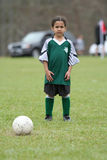 Young Girl Playing Soccer. A young girl playing in a soccer league Stock Photography