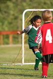 Young Girl Playing Soccer. A young girl playing in a soccer league Stock Image