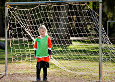 Young girl playing soccer in goal Royalty Free Stock Image