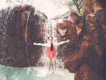 Young Girl playing and splashing in a waterfall Stock Photos
