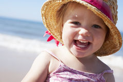 Young Girl Playing On Sunny Beach Stock Images