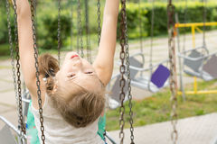 Young girl playing on a swing Stock Photography