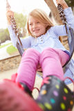 Young Girl Playing On Swing In Playground Stock Images