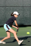 Young girl playing tennis royalty free stock images