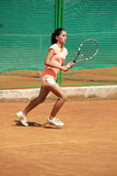 Young girl playing tennis on the court. Photo of the Young girl playing tennis on the court Royalty Free Stock Photo