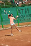 Young girl playing tennis on the court. Photo of the Young girl playing tennis on the court Royalty Free Stock Photos