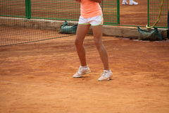 Young girl playing tennis on the court. Photo of the Young girl playing tennis on the court Stock Images