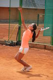 Young girl playing tennis on the court. Photo of the Young girl playing tennis on the court Stock Image