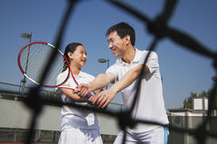 Young girl playing tennis with her coach Royalty Free Stock Image