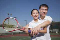 Young girl playing tennis with her coach Royalty Free Stock Photography