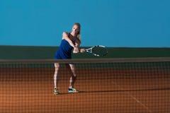Young Girl Playing Tennis Hitting Ball Royalty Free Stock Photos