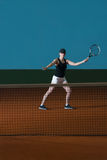 Young Girl Playing Tennis Hitting Ball stock images