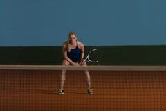 Young Girl Playing Tennis Hitting Ball stock photos