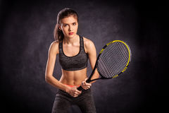 Young girl playing tennis with racket Stock Photos