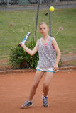Young girl playing tennis Royalty Free Stock Photos