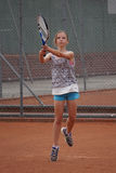 Young girl playing tennis Royalty Free Stock Photo