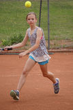 Young girl playing tennis stock photography