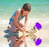 Young Girl Playing by Tidepool stock images