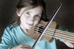 Young Girl Playing Toy Violin Royalty Free Stock Photos