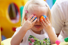 Young girl playing with toys stock images