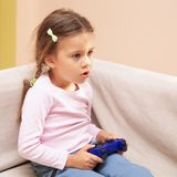 Young Girl playing Video Game Royalty Free Stock Images