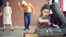 Little girl DJ playing on vinyl stock video footage