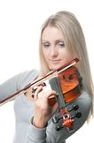 Young  girl playing the violin Stock Photo