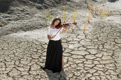 Young girl playing violin Stock Images