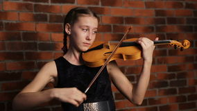 Young girl playing violin stock video footage