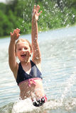 Young girl playing in the water. Stock Images