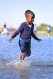 Young girl playing with water Royalty Free Stock Photo