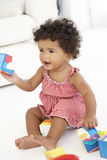 Young Girl Playing With Wooden Building Blocks royalty free stock image