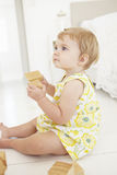 Young Girl Playing With Wooden Building Blocks In Bedroom Royalty Free Stock Photography