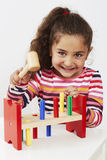 Young girl playing with wooden toy Stock Image