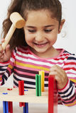 Young girl playing with wooden toy Stock Photo