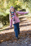 Young girl playing in woods Royalty Free Stock Photo