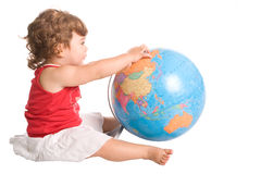 Young girl playing with a world globe Stock Photos