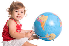 Young girl playing with a world globe map Royalty Free Stock Photo