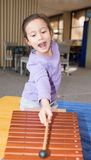 Young Girl Playing Xylophone. Royalty Free Stock Photography